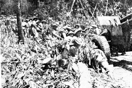 NVA gunners moving artillery uphill.