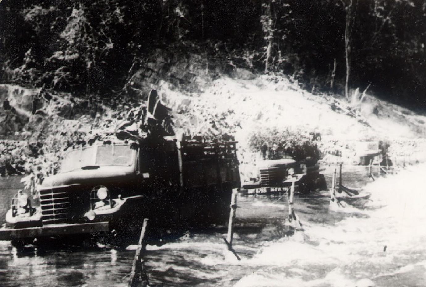 Viet Minh Trucks Fording a Stream