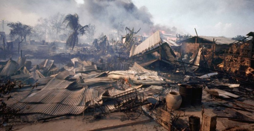 Cholon District market covered in smoke and debris after Tet Offensive