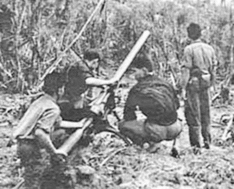 Viet Cong loading a Chinese 75mm recoilless rifle. The photo was discovered by the 5th Royal Australian Regiment during a bunker search in 1967. The Viet Minh SKZ was a similar weapon.