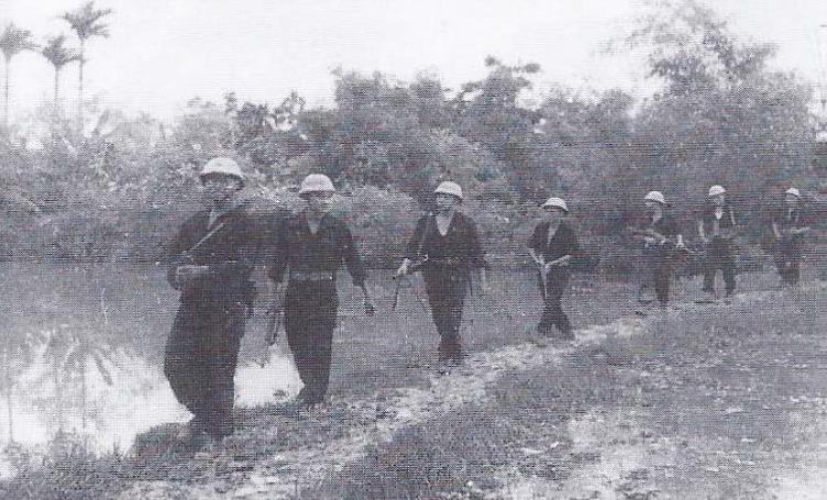 Commando 24 on Patrol - Note similarity to Viet Minh Uniforms